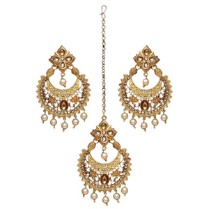 Beautiful gold detail tikka and earring set with faux pearls to make the perfect statement at an event, party or special occasion.