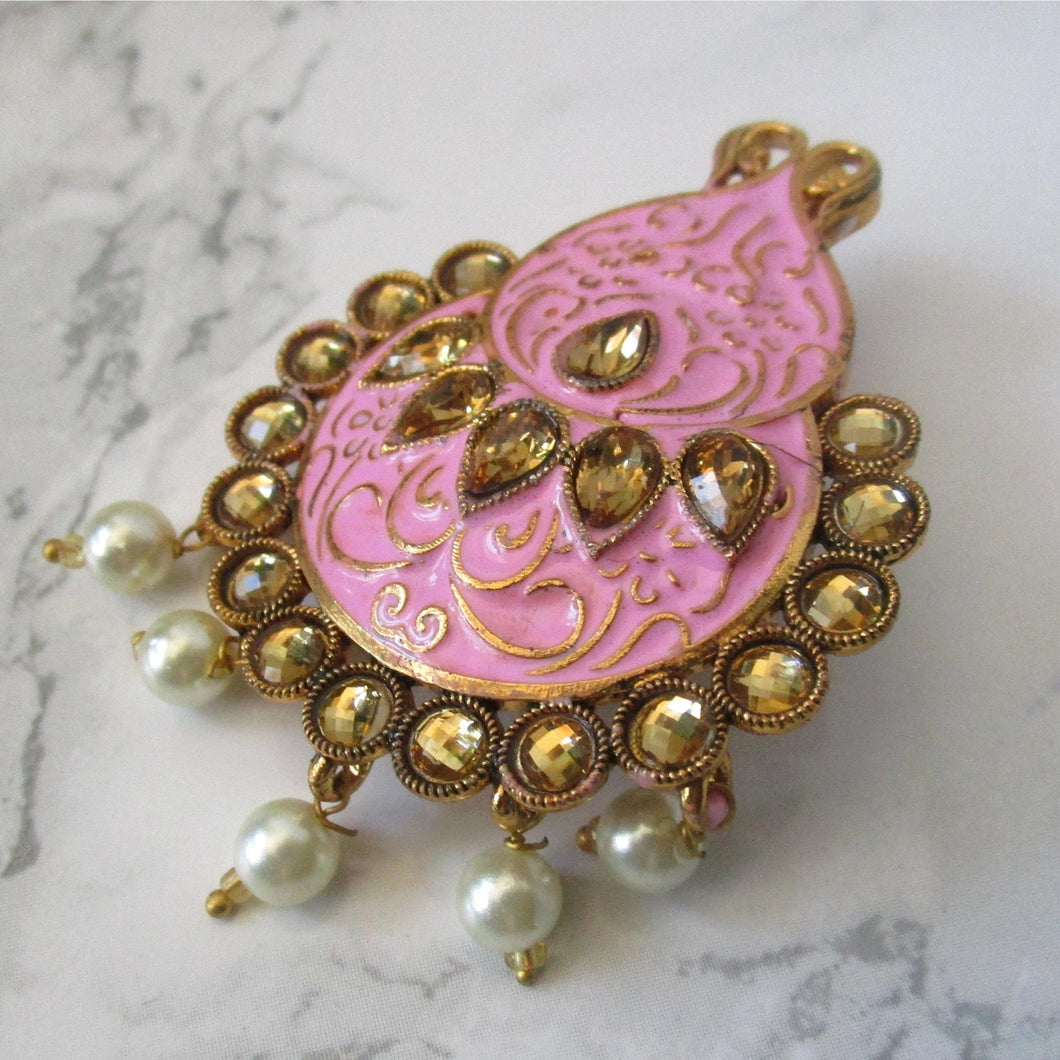 beautiful hand painted pink faux pearl brooch. This brooch is perfect for blazers, jackets and as a saree pin. This pin will make a beautiful statement piece.
