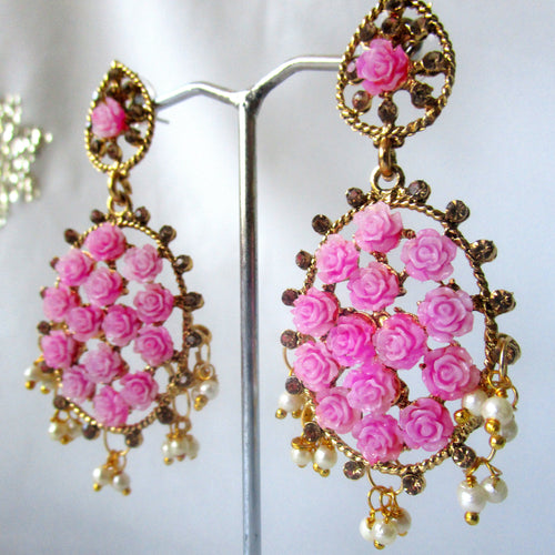 Gorgeous pink oval shaped drop earrings with faux pearl detail at the bottom and small pink roses in the earring itself. Beautiful statement earrings suitable for everyday or special occasions.