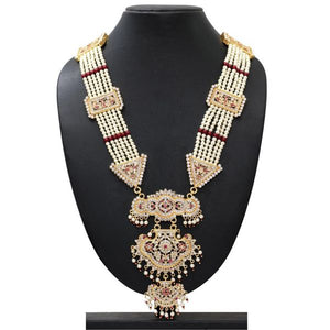 Truly beautiful and regal rani haar necklace with gold, faux pearl and faux ruby detail to really make a statement. The detail at the bottom is really exquisite. This necklace is perfect for special occasions.
