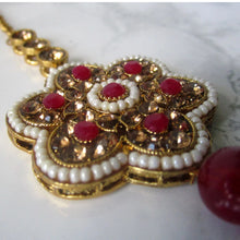 Load image into Gallery viewer, Gold and red large flower tikka with faux pearl detail. This statement piece is perfect for special occasions and parties.