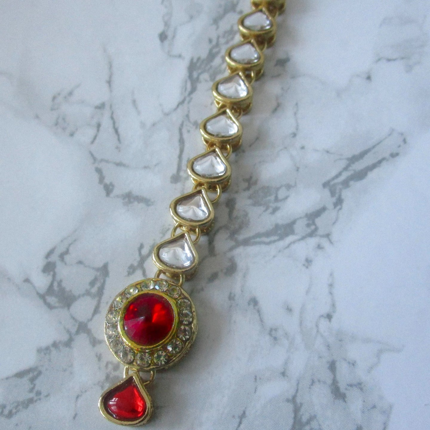 Simple Red Tikka with gold metal and stone detail