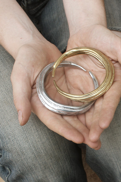 Aether Bangle silver Image - Held by model