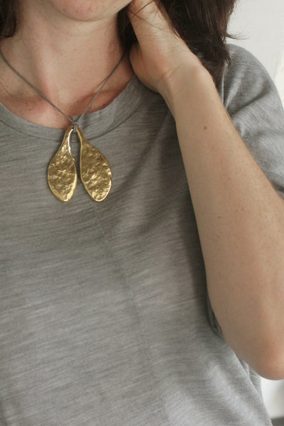 Quarry Small Leaf Pendent Gold Image - Worn by model