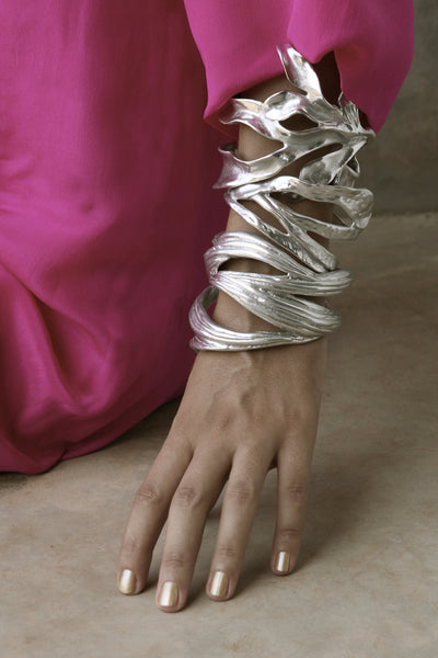 The statement Sirena Cuff stacked with other beauties.