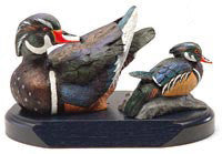 Wood Ducks with Spreaded Wings on a Base