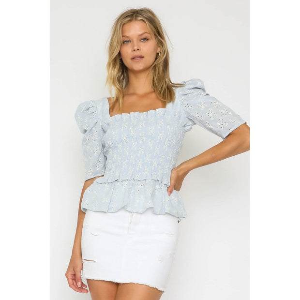 Puff sleeve top with smocked body and ruffle trip