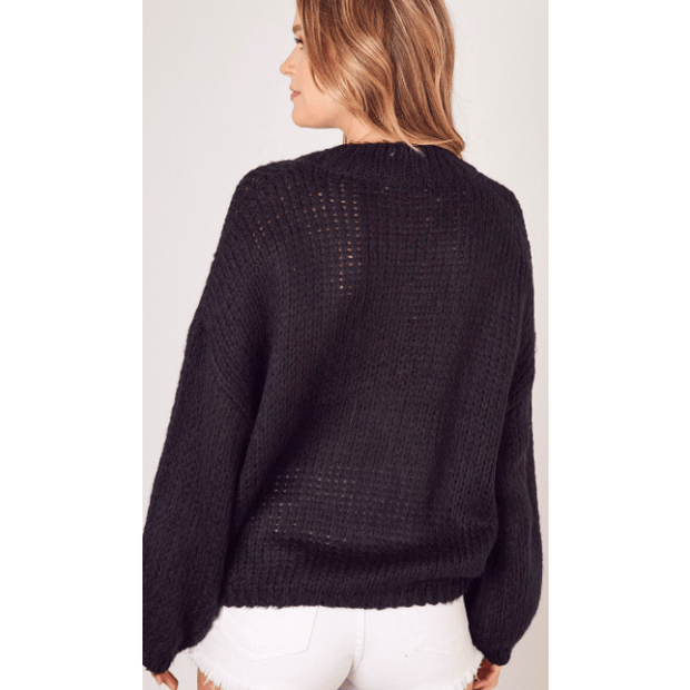 Black knitted sweater with slight mock neck and chunky