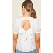 White puff sleeve top with open back and bow tie