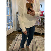Destroyed ivory V neck sweater with colored stars