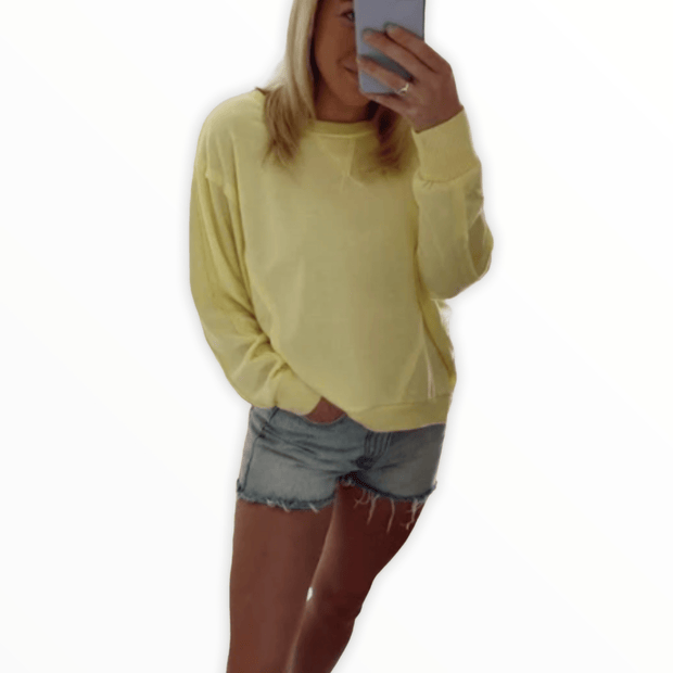 Exposed seam yellow pullover
