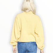 Acid wash mock neck yellow pullover