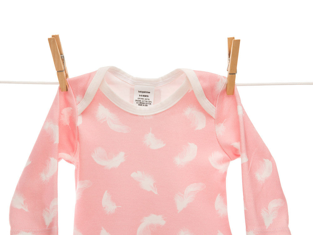 Organic soft pink feather onesie dress