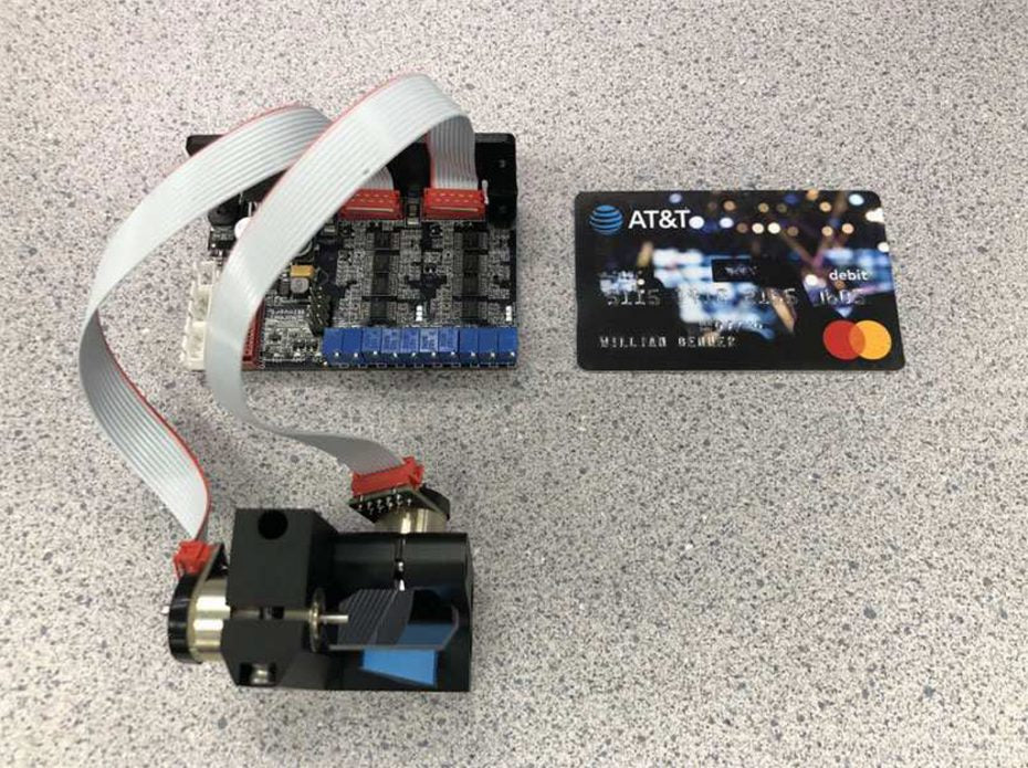 Scanner and driver compared to a credit card