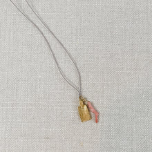 Load image into Gallery viewer, Pink coral and gold tag charm necklace, strung on grey silk cord.