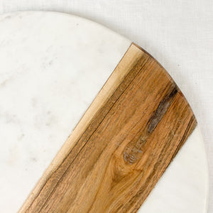 "White marble with natural wood serving board, round. Measures 12"" diameter."