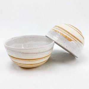 Ceramic Bowl made from swirls of cream and sand stoneware, hand dipped in a creamy white glaze. Each sold individually.