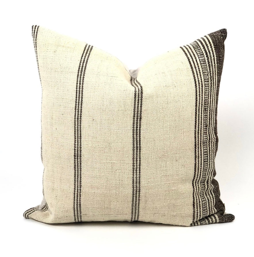 Rustic cream pillow with varigated woven brown stripes