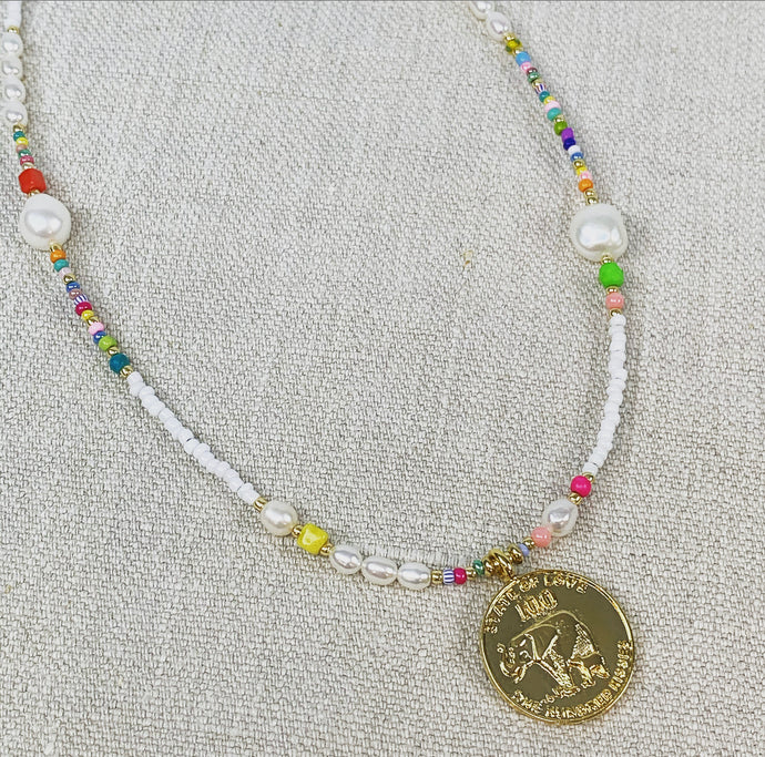 Pearl and multi color bead necklace with gold coin charm.