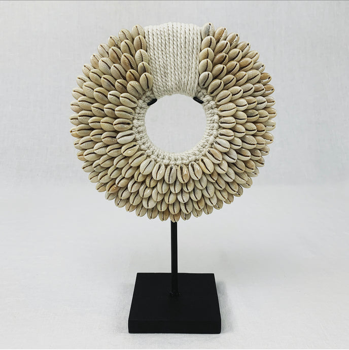 Tribal Shell Necklace display made from natural cowrie shells. Comes with a black display stand.