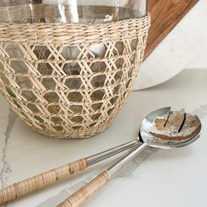 Rattan wrapped salad serving set shown with Seagrass Cage Serving Bowl. Sold separately.