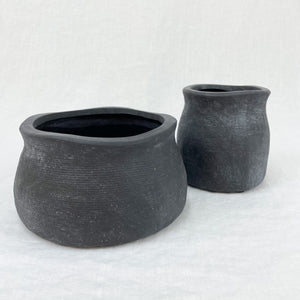 The Flanders Farmhouse vessel and vase shown in matte black ceramic. Each sold  separately.