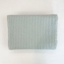 Load image into Gallery viewer, Simple Waffle Weave Bath Towel by Hawkins NY. A modern essential for the bathroom. Made in Portugal in a 100% cotton waffle weave. Stone washed for extra softness. Sky Blue color.