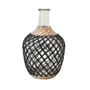 "Mediterranean Seagrass Decanter. Glass bottle is wrapped in hand woven black and natural seagrass cage. Measures 10.25""H, 5"" diameter. Hand wash only."