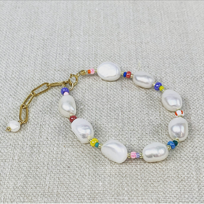 Fresh water pearls and multi colored seed bead bracelet.