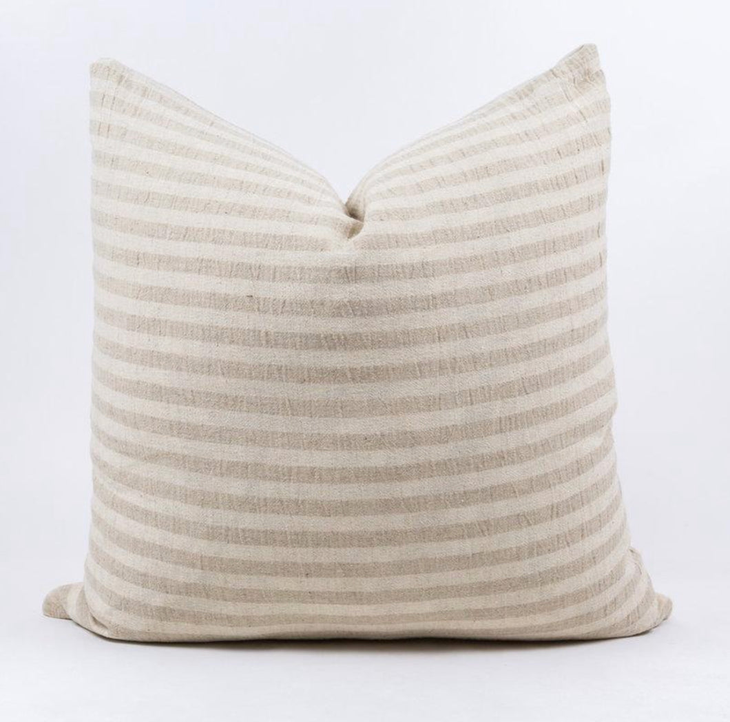 Throw pillow in cream and tan stripe
