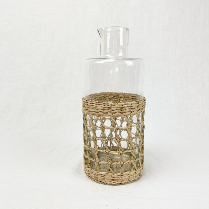 Glass carafe with hand woven seagrass cage.