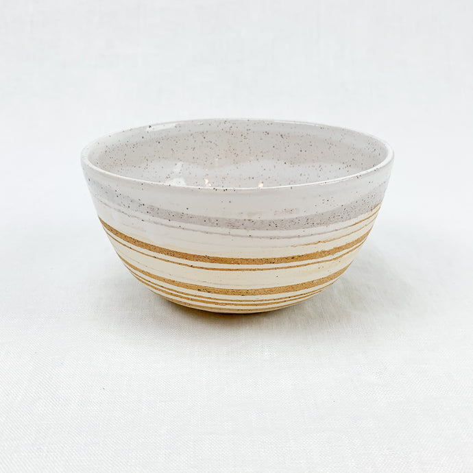 Ceramic Bowl with swirls of cream and sand stoneware, hand dipped in a creamy white glaze. By Rockwater Pottery.