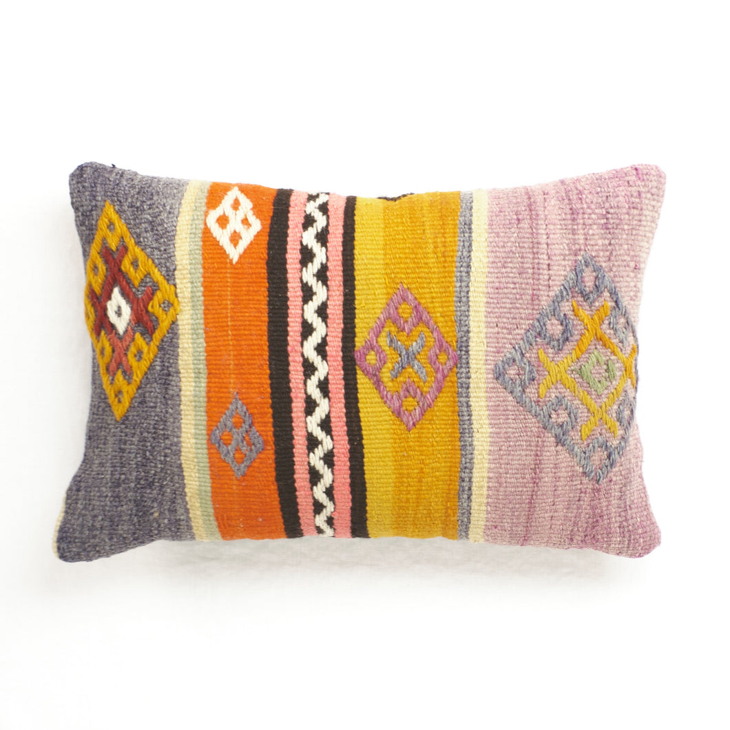 Vintage kilim pillow with violet, orange, saffron, pink and brown stripes. Tan cotton twill back.