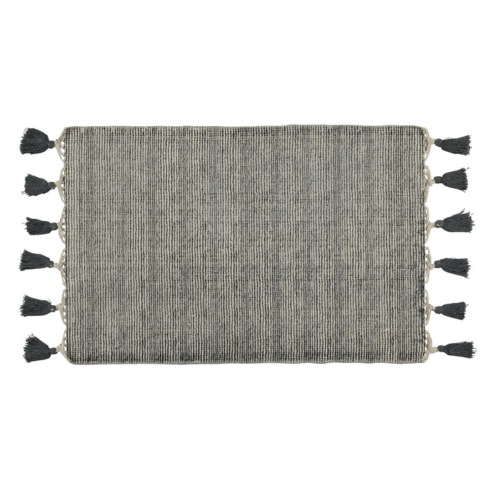 dark grey and natural striped flatweave rug with grey tassels