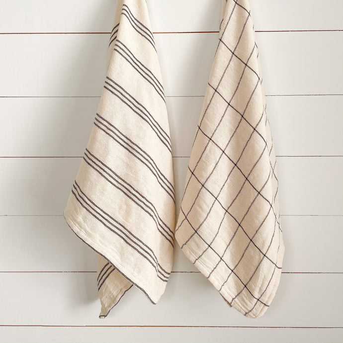 Set of 2 kitchen towels with cream and black window pane and stripe pattern.