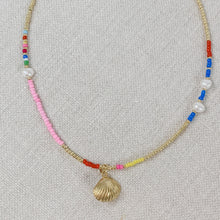 Load image into Gallery viewer, Beaded choker necklace with rainbow seed beads, pearls and a gold plated shell charm.