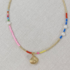 Beaded choker necklace with rainbow seed beads, pearls and a gold plated shell charm.