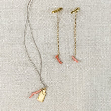 Load image into Gallery viewer, Delicate gold chain drop earrings with pink coral charm shown with coordinating necklace. By Takara jewelry.