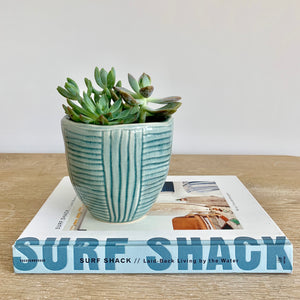 small ceramic pot with glossy blue-green glaze