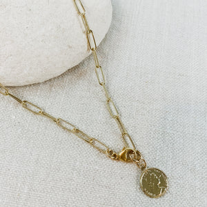 Gold chain link necklace with small vintage coin. Designed by Katie Waltman.