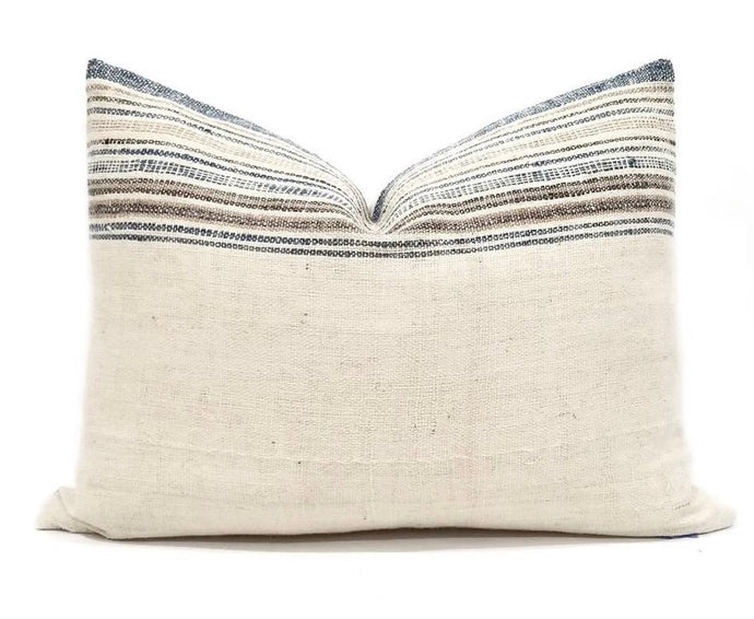 Lumbar pillow with artisan textile cover in cream with blue, tan and brown stripe border