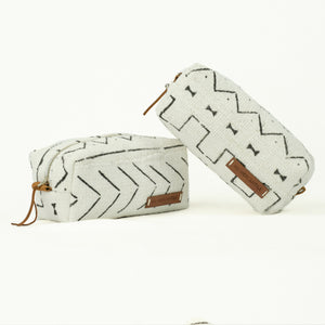 white and black mud cloth make up bags