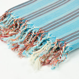 Turkish towel in turquoise with white and orange stripes