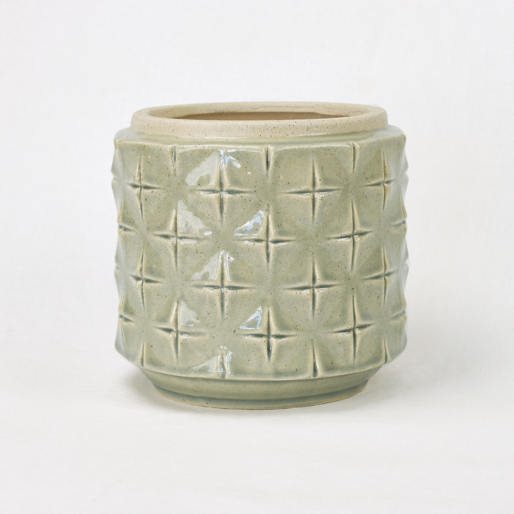 celadon green ceramic pot with cross etched pattern
