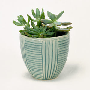 ceramic pot in blue-green with linear etching