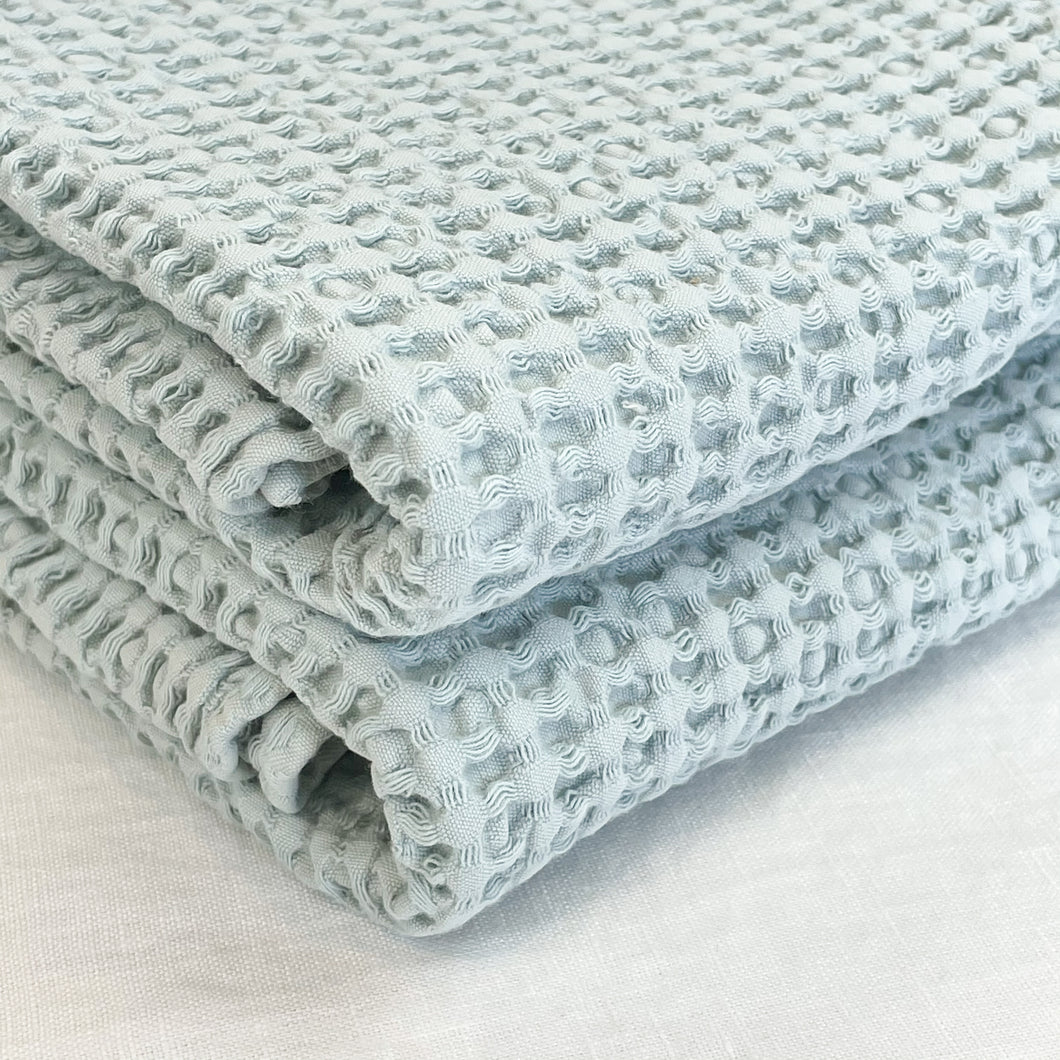 Simple Waffle Bath Towel made by Hawkins NY. A modern essential for the bathroom. Made in Portugal in a super absorbent waffle weave in  sky blue. Stone washed for an extra soft hand feel.