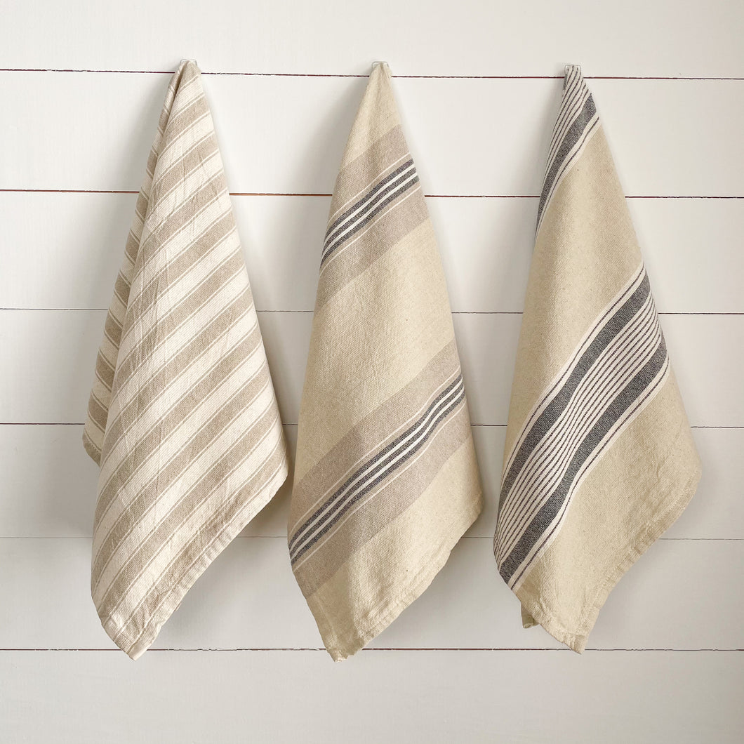 Set of 3 kitchen towels in beige and grey ticking stripes.