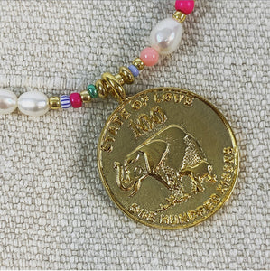 Pearl and beaded necklace with gold coin charm.