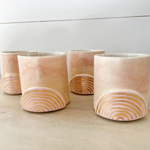 Golden Rainbow Ceramic Tumblers. Small cup with blush pink glaze and hand painted gold rainbow. Each sold separately.
