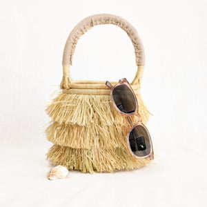 Mini basket bag with raffia fringe by Indego Africa
